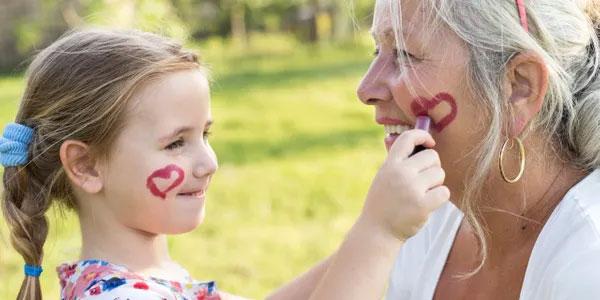 Child draws on mom's face